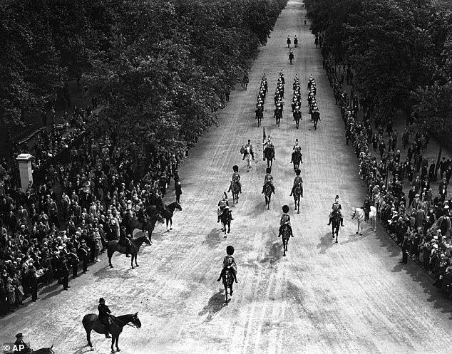 Britain's King Edward VIII, left,nears Wellington Arch as he rides from Buckingham Palace to Hyde Park, in London, on July 16, 1936 just before the assassination attempt