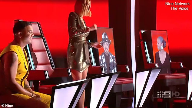 Sign of the times!The Voice Australia has revealed its new socially distanced set in a promo clip aired on Monday night. Pictured: Guy Sebastian, Delta Goodrem, and on video screens sitting in seats, Boy George and Kelly Rowland