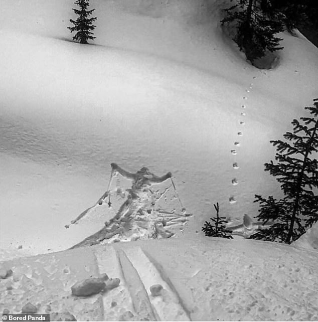 A skier appears to have taken a plunge in this black and white image. It is unclear where or when the photograph was originally taken