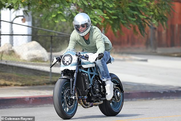 Pitt, 56, rode a flashy motorcycle away from Jolie's $24 million home in a gated community in Los Feliz after the visit on Tuesday afternoon