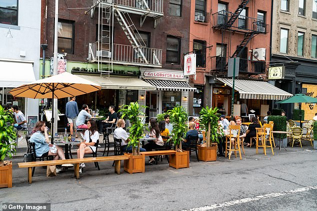 'The rest of Phase 3 is moving on pace for Monday, July 6, but the indoor dining element is now in question,' de Blasio said. Customers dine outside two restaurants in Manhattan on June 27