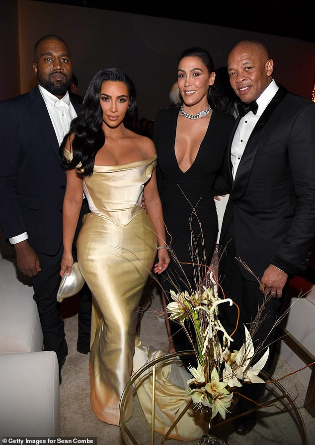 Famous: Dre and wife Nicole pictured with Kanye West and Kim Kardashian West at Sean Combs 50th birthday party on December 14, 2019 in Los Angeles