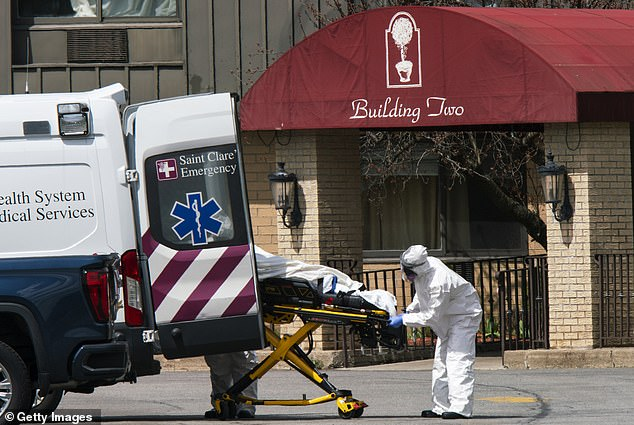 Excess deaths due to Alzheimer's and dementia surpassed 1,000 in California, New Jersey, New York and Texas. Pictured:Pictured: Medical workers load a deceased body from Andover Subacute and Rehabilitation Center into an ambulance in Andover, New Jersey, April 16