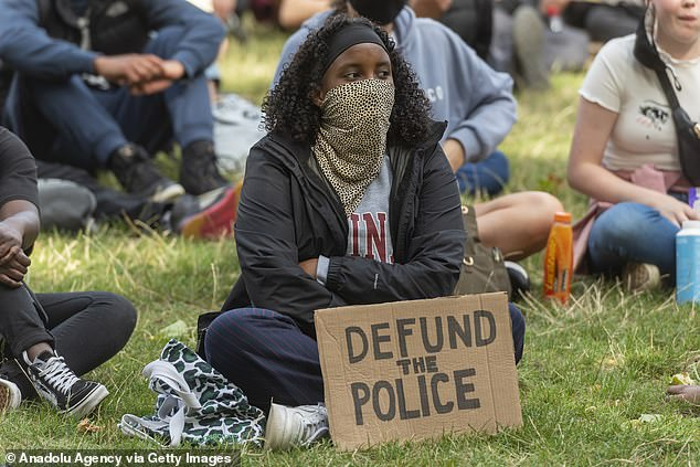 Black Lives Matter calls to 'defund the police', as demonstrated in a sign at a protest on Sunday, pictured, have been rubbished as 'nonsense' by the Labour leader
