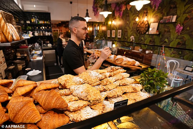 Business owners claim staff were choosing to go JobSeeker instead of returning to work (pictured, a reopened Melbourne cafe on June 21)
