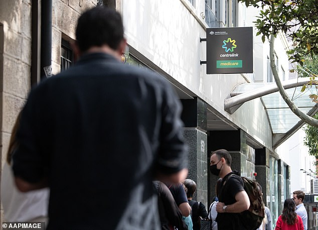 JobSeeker payments were doubled from $275-a-week to $550-a-week amid the coronavirus pandemic (pictured, people queue for access to a Centrelink Service Centre in Sydney)