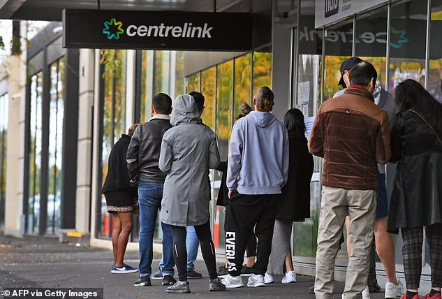 More than 2.2 million Australians have dipped into their super since April after falling on hard times during the coronavirus pandemic (pictured are Centrelink queues in Melbourne)