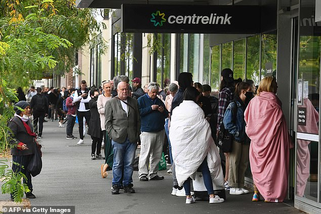The coronavirus pandemic left many businesses forced to shut their doors, leaving thousands out of work (pictured, queues outside Centrelink on March 23)