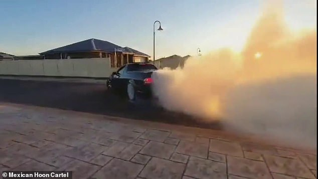 The gang said 90 per cent of their members would stop drifting on suburban roads if a designated location was available (pictured - a still from a Mexican Hoon Cartel video of a car performing a burnout)