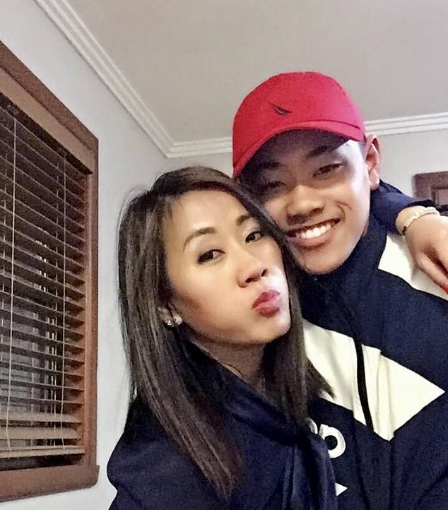 Tran, 20, (pictured with his mum Amy) was allegedly killed when he got caught up in a fight as he walked home from a gym in Oakleigh, a suburb in the city's south-east, on Monday evening