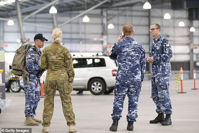 Soldiers in camo gear have converged on Melbourne amid fears suburbs may be locked down by Australian Defence Force troops