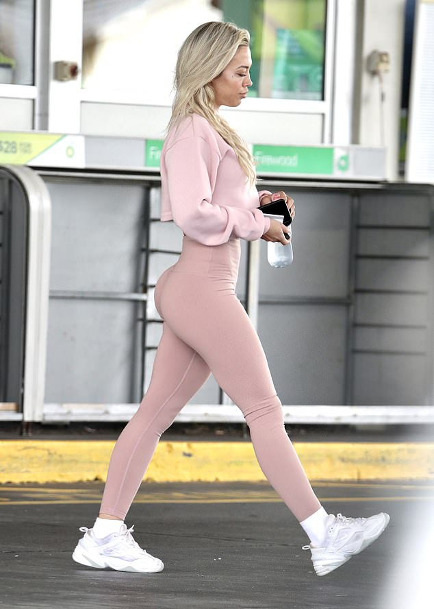 Flaunting it: Dressed in a pale pink ensemble from her activewear line, Saski Collection, Tammy showed off her unbelievably flat muscular stomach and famous rounded derriere in tight activewear