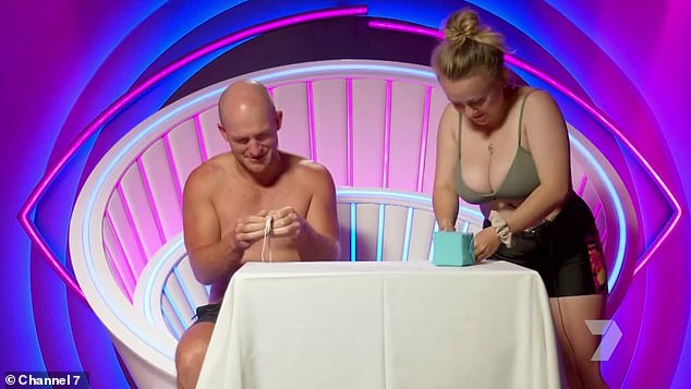 Attention! Army cadet Sarah McDougal (right) gave viewers an eyeful during Tuesday's episode of Big Brother. Pictured in the diary room with Mat Garrick (left)