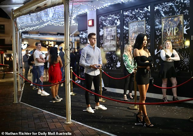 Music festivals and nightclubs will remain closed (pictured, clubbers in the Gold Coast, where clubs can reopen but dancing is banned)