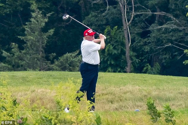 Two officials said that they couldn't reach the president for over three hours and aides also tried unsuccessfully to reach deputy chief of staff Dan Scavino to ask him to delete the retweet because Trump put his phone down while golfing. The president pictured golfing on Saturday