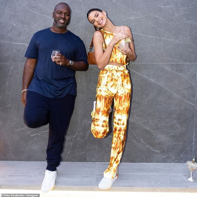 Pals: The model bared her best smile in the same spot, this time with Kris' boyfriend Corey Gamble, who wore a simple navy T-shirt with blue sweatpants and white athletic sneakers