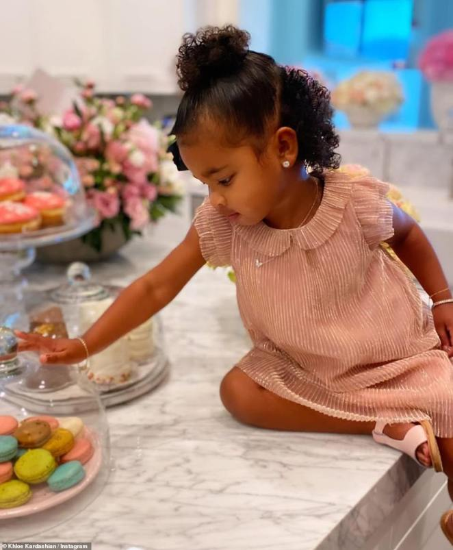 Ready for a snack: 'I love you,' she captioned the snaps of her daughter hungrily eyeing a mouthwatering stack of macarons