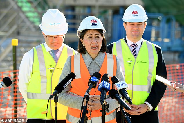 New South Premier Gladys Berejiklian (centre), Minister for WestConnex Stuart Ayres (right) and Member for Oatley Mark Coure (left) speak to the media at the WestConnex New M5 St Peters interchange in 2018
