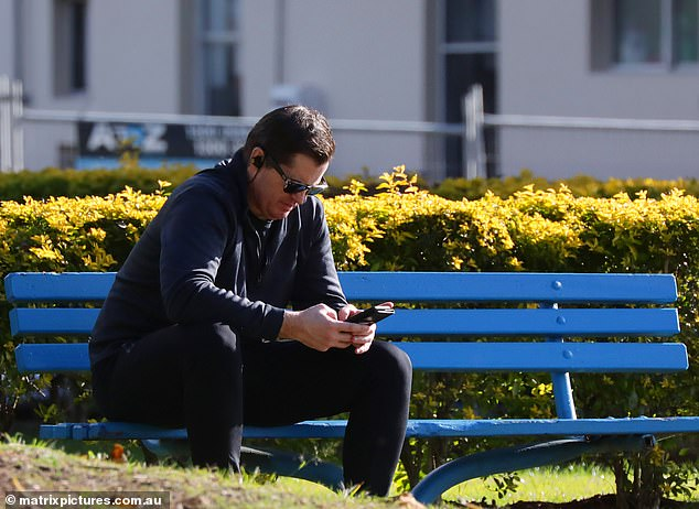 Embattled television star Ryan Phelan (pictured) has taken a lonely walk through a Sydney park just hours after his first fronting court over allegations of assaulting his girlfriend