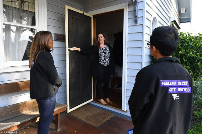 Rules forcing patients to stay in their homes could be enforced more strictly with daily check-ups. Pictured: Community engagement teams are door knocking residents in coronavirus hotspots to provide additional information about the virus