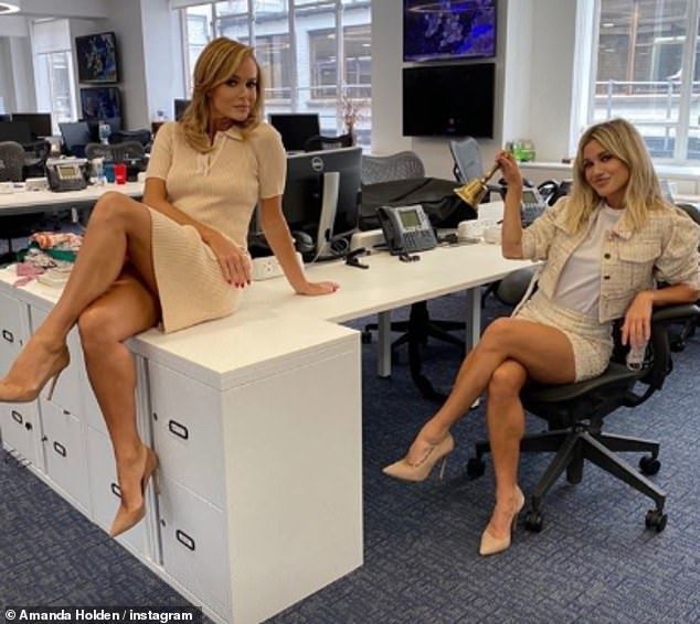 High on the leg! Feeling playful behind-the-scenes, she has joined fellow radio host Ashley Roberts in the installation of a storm on a desk inside the isolated Global Radio building