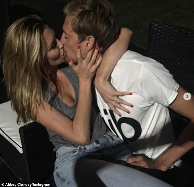 Besotted:Taking to Instagram, model Abbey, 34, shared a series of throwback snaps with her footballer beau, 39, as she shared a sweet tribute to him on their anniversary