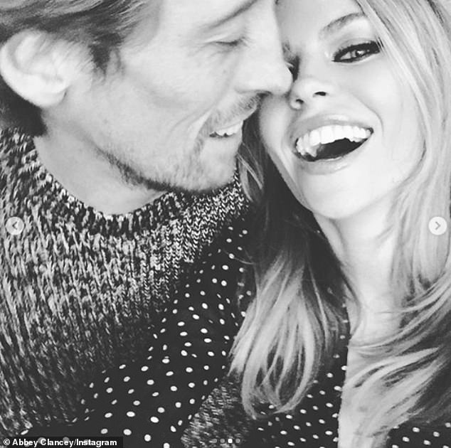 Loved up:Abbey Clancy and Peter Crouch proved they were happier than ever as they celebrated nine years of marriage on Tuesday
