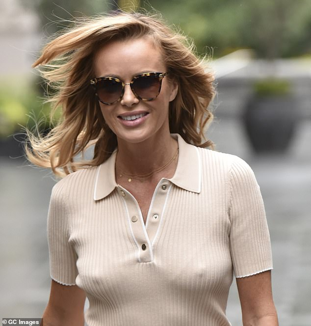 Oh my! Amanda Holden was once again the display of his magnificent style, Tuesday, as she donned a skin-tight nude top while heading to work at the Heart of the Radio