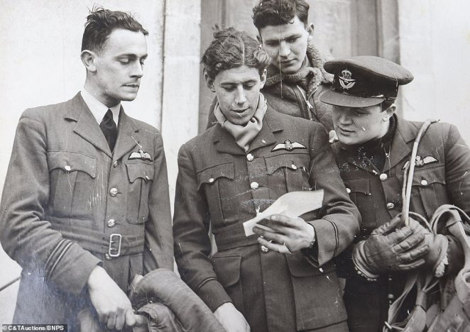 Another image shows members of Winston Churchill's famous  'Few' looking at a note away while back on the ground. The scenes shed a new light on the experiences shared by the legion of officers who bravely fought in the air battle in 1940