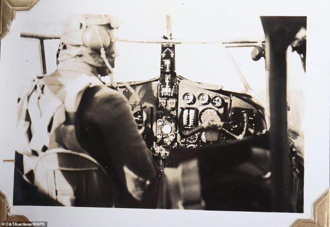 Among the black and white images set to go on sale next month is one showing a pilot wearing their uniform as they sit inside the cockpit while in flight