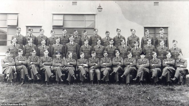 The legion of officers (pictured sitting for a photo), who were hailed as 'The Few' by Winston Churchill  played a crucial role in the defeat of the Luftwaffe in the Battle of Britain