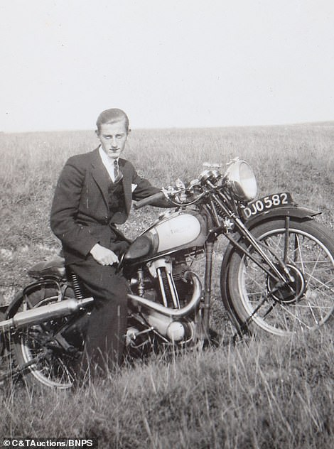 One man sits on a motorbike while wearing suit while off-duty