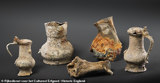 Many of the finds from the wreck are covered with hard concretions of matter that will require the extra power of the new equipment to be successfully scanned. Pictured, pewter jugs recovered from theRooswijk