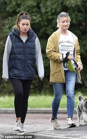 Day out: Alison appeared in good spirits as she chatted away with her pal as they made their way around town with the pooches in tow