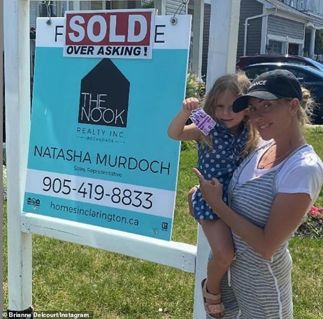 Sold! Brianne also shared a snap of herself and her daughter posing next to her house, which she has sold for over the asking price.