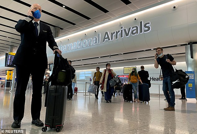 Quarantine for international arrivals in Britain has only been introduced now that there are tens of thousands of cases inside the country - it was snubbed at the start of the pandemic (Pictured: People at Heathrow Airport in London)