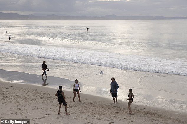 People play football on Main Beach on June 20, 2020 in Byron Bay, Australia. Domestic tourists have started to return to Byron Bay following the easing of travel restrictions