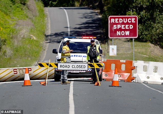 Police will randomly pull cars over in Victoria to ensure the occupants are not from the locked down suburbs. Queensland will also stop Victorians entering the state while letting all other Australians in from July 10. Pictured: The border near the Gold Coast