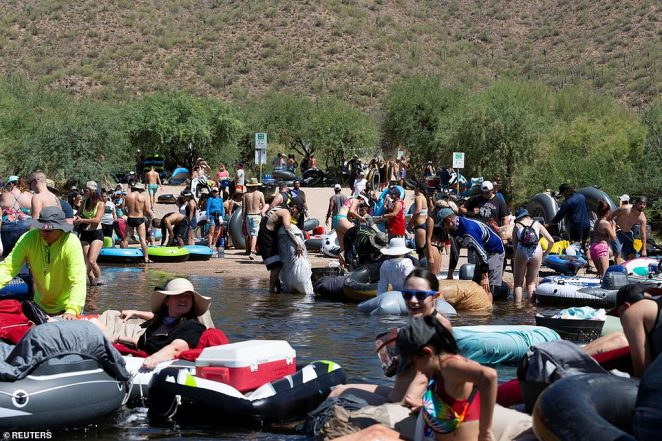 Large crowds of young people were spotted out as recently as Saturday tubing on Arizona's Salt River. Arizona Gov Doug Ducey on Monday ordered all bars, gyms, movie theaters and water parks to close for at least 30 days