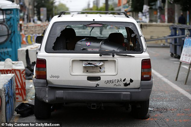 Witnesses had reported seeing a white Jeep SUV near one of the makeshift barriers around the protest zone about 3 a.m. Monday, just before the shooting