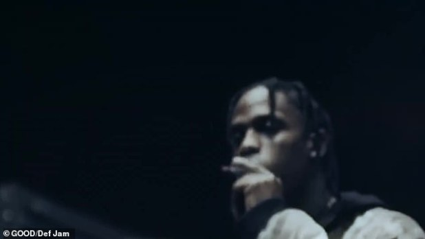 All in the family: Seven-time Grammy nominee Travis Scott, who has a daughter with Kanye's sister-in-law Kylie Jenner, is featured on the song and makes a cameo smoking in the video
