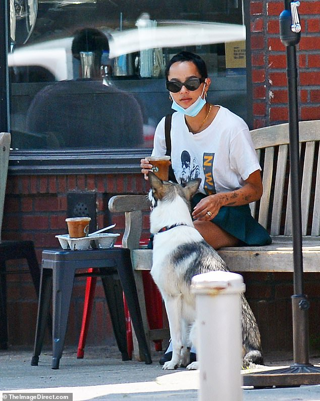 Time out:Taking a quick breather, Kravitz set her belongings down on a nearby bench where she enjoyed a sip from her cool drink with Scout sitting at her feet