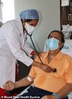 Deepak Gulati, 71, from New York City, began feeling tightness in his chest on June 18. Pictured: Gulati being examined by Dr Annapoor Kini, a cardiologist at The Mount Sinai Hospital