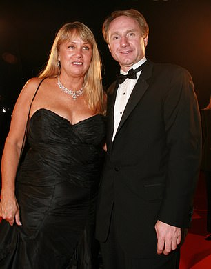 The Da Vinci Code author, Dan Brown, is being sued by his ex-wife, Blythe Brown (pictured together) for allegedly leading a double life and 'secretly siphoning' off large amounts of money to have affairs with multiple women