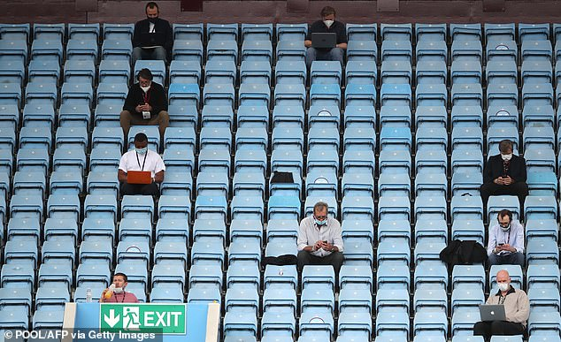 On days with no wind, respiratory droplets can travel between eight and 13 feet. Pictured: Journalists in the stands at the English Premier League football match between Aston Villa and Chelsea at Villa Park in Birmingham, England, June 21