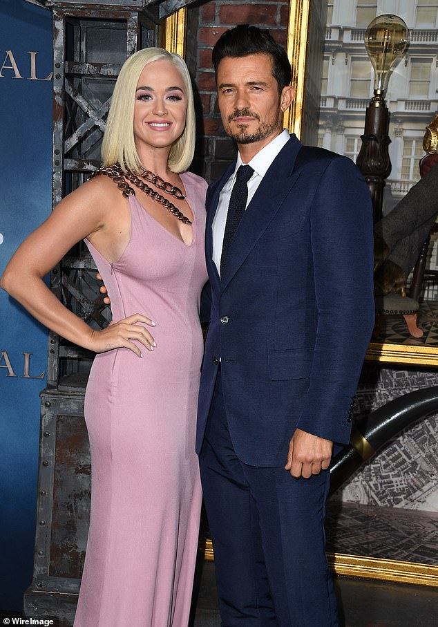 Touching:Orlando Bloom has revealed he's in awe of his pregnant fiancée Katy Perry as she prepares to give birth to their first child (pictured together in August 2019)