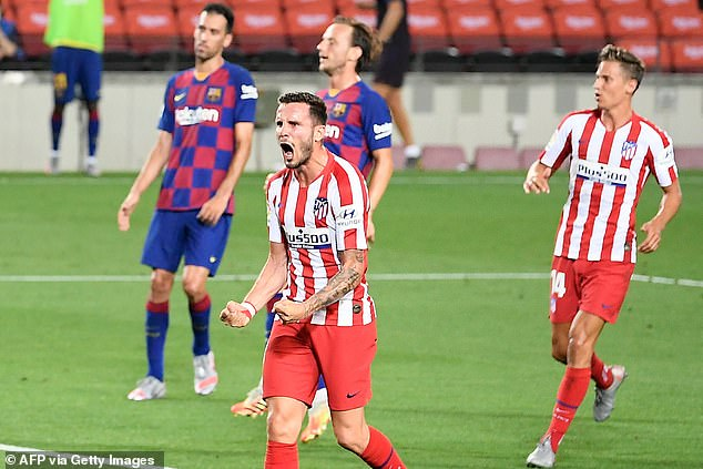 Saul Niguez celebrates after scoring his second penalty against Barcelona at the Nou Camp