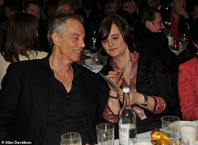 Where on earth did Tony Blair get the idea for that absurd gold necklace he was wearing around his neck. He was even wearing a Burt Reynolds-style open shirt