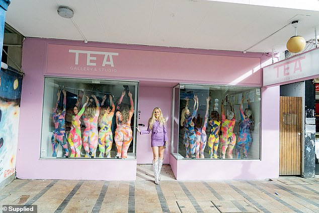 On June 28 the Manchester-born beauty, who sells her work for between $700 and $3,500, opened her first pink-painted gallery in Manly Beach, Sydney (pictured)