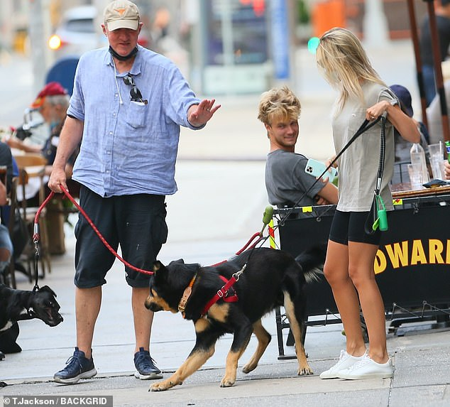 She managed to keep a hold of the boisterous pooch, though, who wore a red harness with his leather leash
